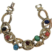 Gold-tone Link Bracelet with Snakes and Flowers
