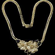 Beautiful Trifari Necklace with Swirled Ecru Flowers and Black Enameled Leaves
