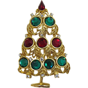 Bright Gold-tone Tipsy Christmas Tree Pin - Red and Green Rhinestones