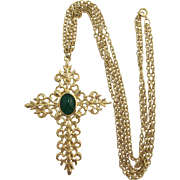 Elaborate Bright Gold-tone Cross with Dark Green Cabochon