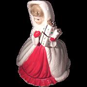 Full Figure Ceramic Girl Holding Christmas Gift Christmas Planter - Red Tag Sale Item