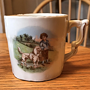 A Boy and his Poodle Child's Mug - Porcelain Circa 1910