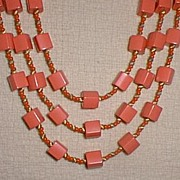 Neat Melon Coral Colored Plastic Beads Necklace