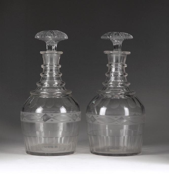 Matching Pair of Georgian, 1820-30, Barrel Cut Decanters