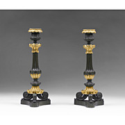 Pair of French Neoclassical Fire Gilded Candlesticks