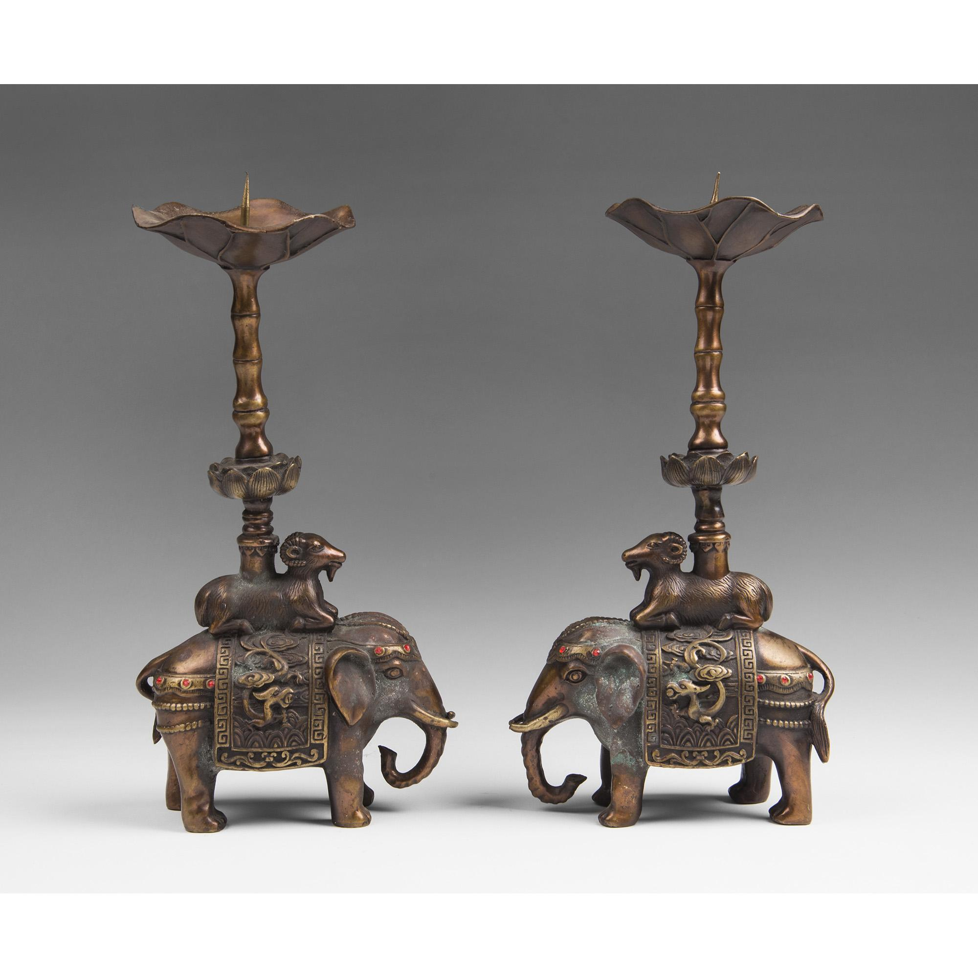 Pair of Chinese Bronze Elephant Form Pricket Candlesticks