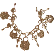 Charming Goldtone Lock & Key Charm Bracelet