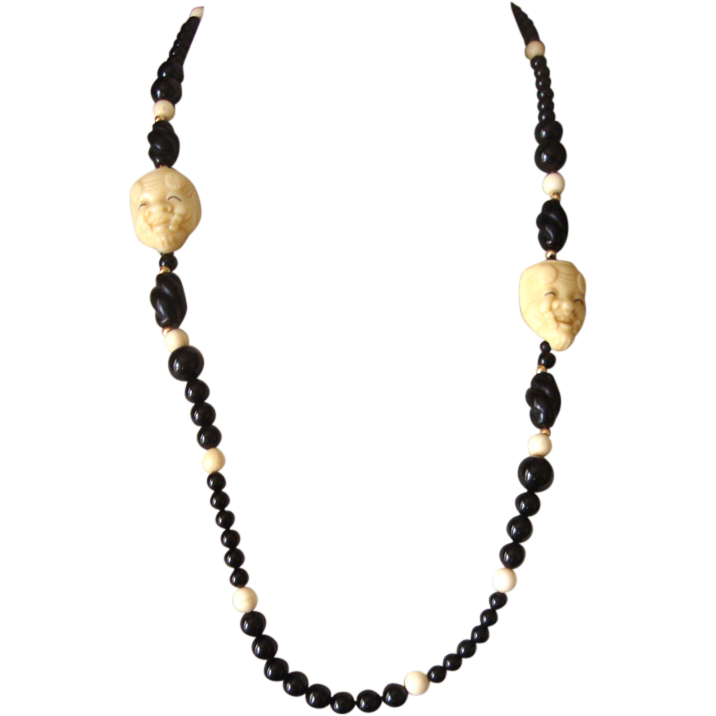 Faux-Ivory Noh Face Necklace: Glass Beads