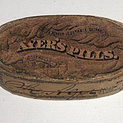 1880s Ayer's Cathartic Wooden Oval Pill Box With Petrified Pills Paper Label