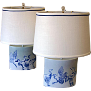 Pair of French hand-painted porcelain lamps