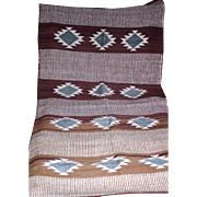 Vintage Navajo saddle blanket in natural dyes