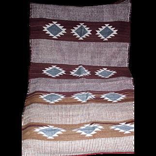 Vintage Navajo saddle blanket in natural dyes