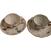 Quasi-pair of German porcelain demi-tasse