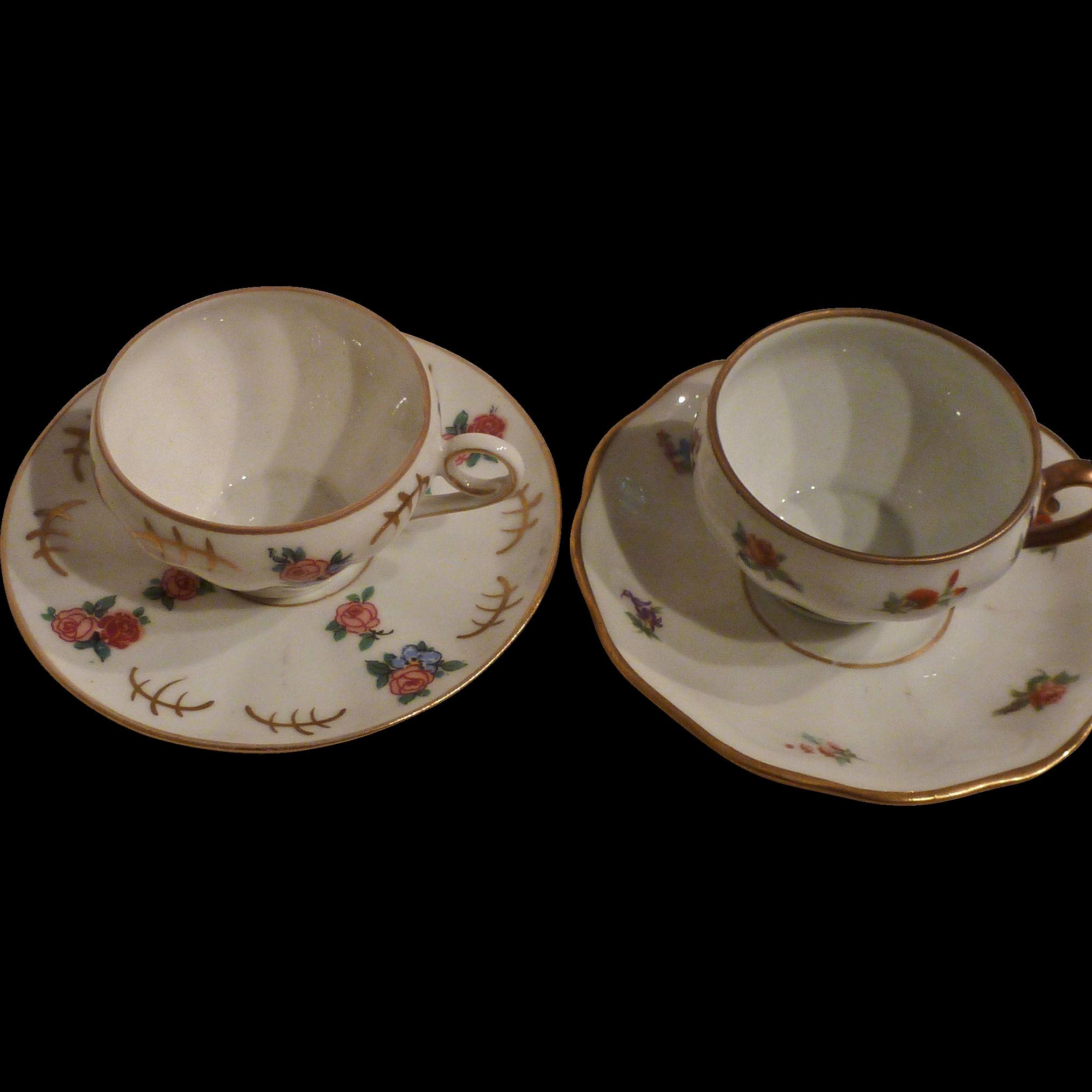 Quasi-pair of German porcelain demi-tasse