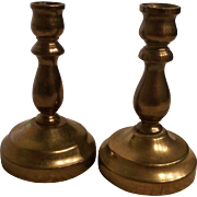 Pair of miniature brass candlesticks
