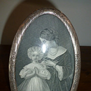 Oval chiseled sterling silver picture frame