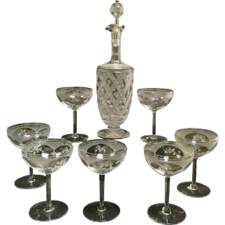 Set of etched crystal decanter and wine glasses