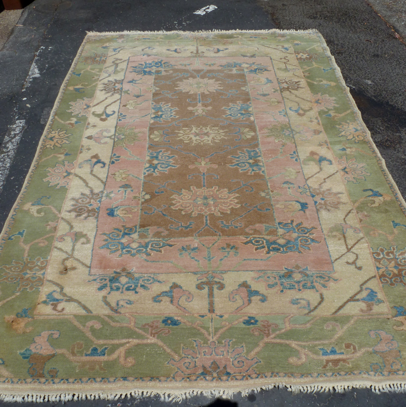 Large hand-knotted Persian rug in light green and ivory tones