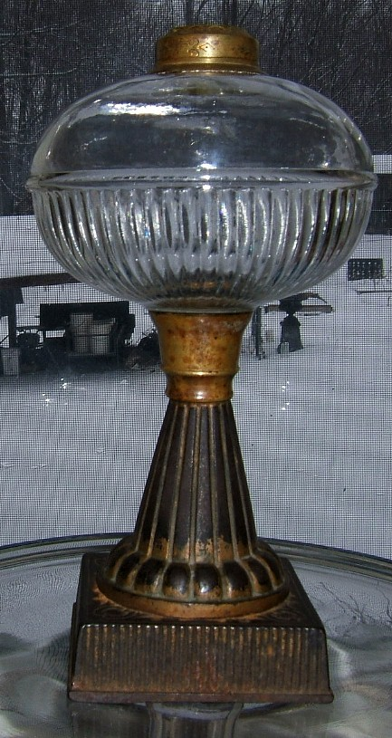 oil lamp with cast iron base and pattern glass font from