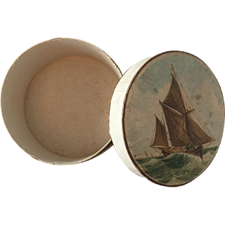 Antique round box with sailing ship scene