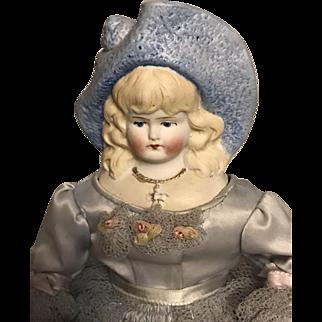 German Bisque Hertwig Bonnet Head Doll