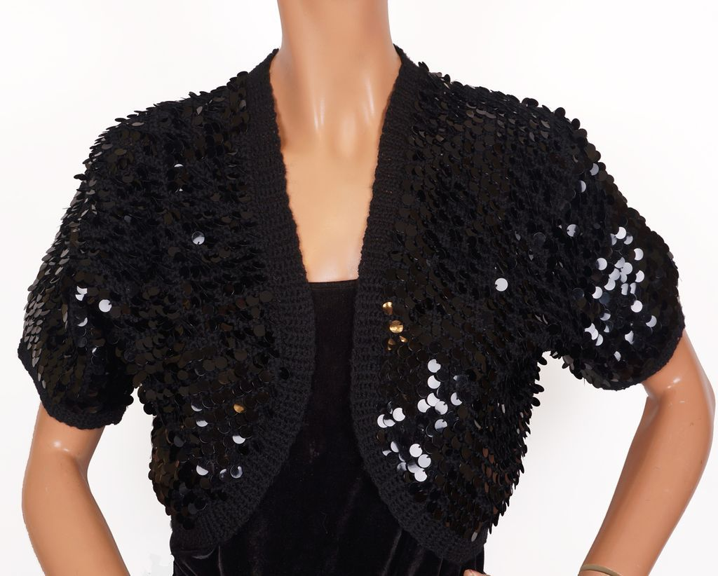 Calvin Klein Women's Angora Open Front Shrug. Sold by Rennde. $ $ Tommy Hilfiger Women's Perforated Back Shrug Cardigan. R & M Richards Womens Solid Black Shrug. Sold by getdangero.ga $ 24/7 Comfort Apparel Goddess Black Lace Bolero Cardigan Shrug.