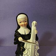Ardalt Nun Playing Cello Musical Instrument