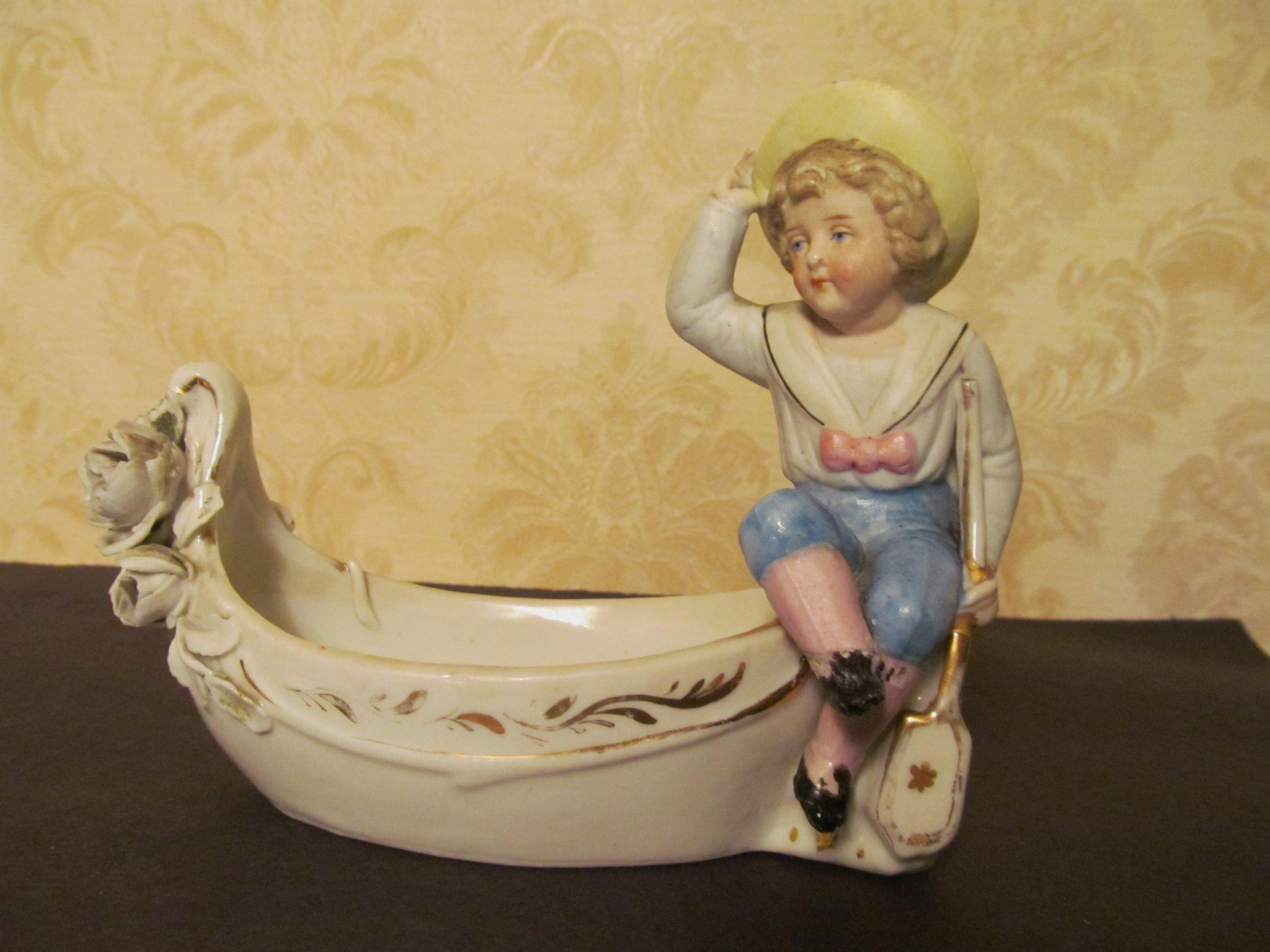 Victorian Boy with Oar in Boat Figurine
