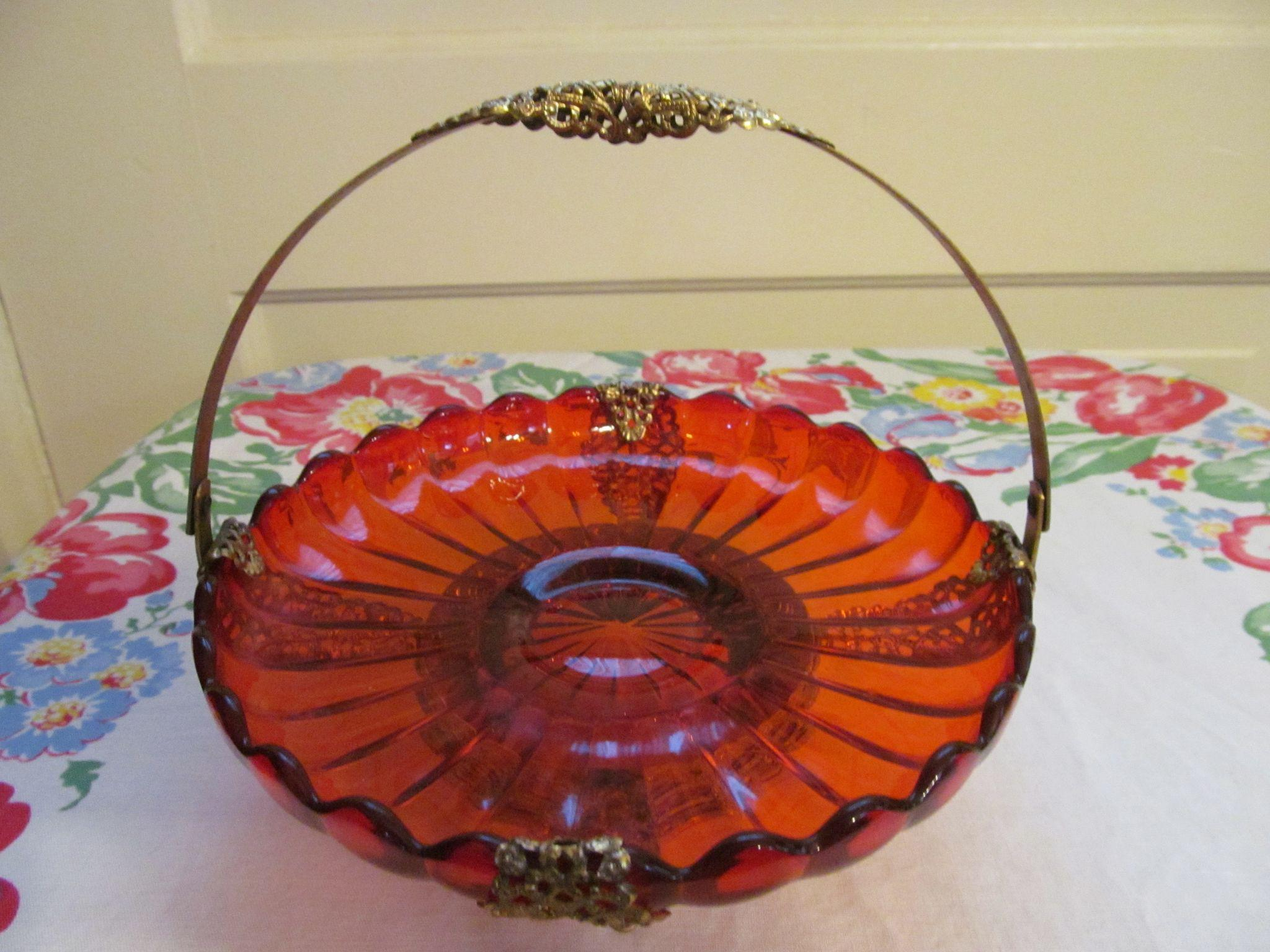 Orange Handled Basket with Footed Gold Metal Frame