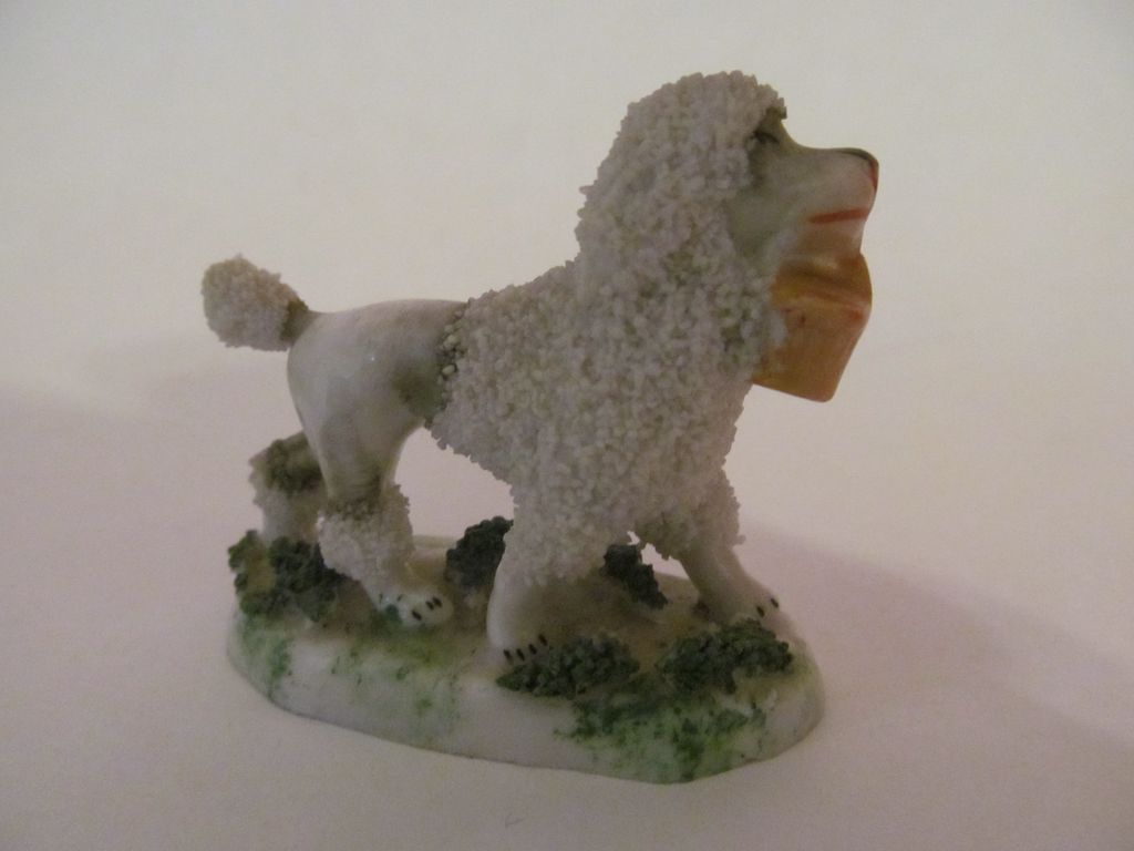 German Porcelain Poodle with Basket Figurine, Crown Over N Mark