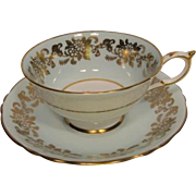 Early PARAGON Blue with Floral Gilt Overlay Tea Cup and Saucer