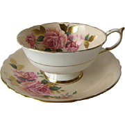 Paragon Tea Rose Grouping on Beige Cup and Saucer