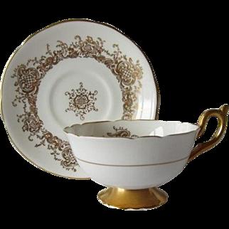 Coalport Elegant Gilt Tea Cup and Saucer