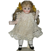 "ALL BISQUE GIRL - 4 1/2"" - Cute Face w/ Brown Glass Eyes - Jointed - Pretty Clothes!!"