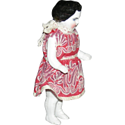 "TINY FROZEN CHARLOTTE - 4 1/4"" - PORCELAIN - Wearing a Red Print Dress!"