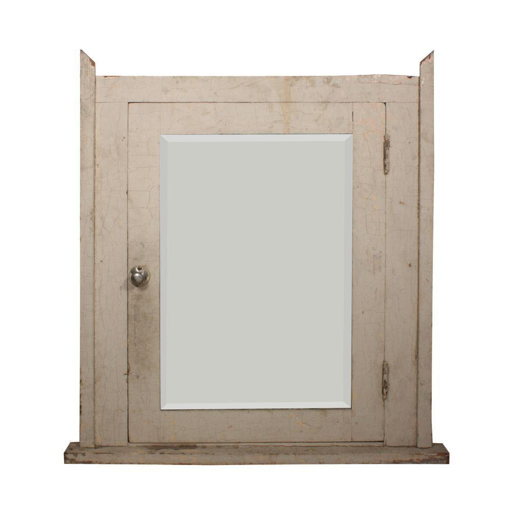 salvaged bathroom medicine cabinet with beveled mirror