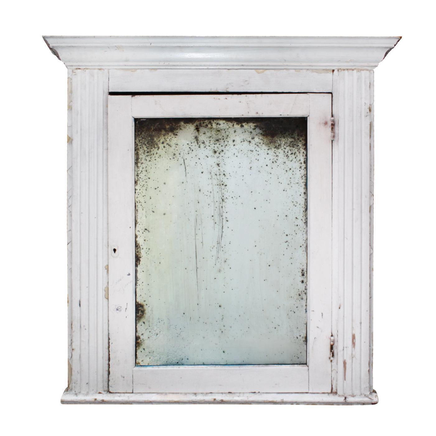 large salvaged bathroom medicine cabinet with aged mirror from