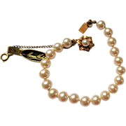 Vintage signed MIRIAM HASKELL simulated pearl bracelet with original paper tag