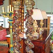 Burgundy & gilt solomonic columns pair