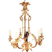 Cage Form Chandelier of Gilt Bronze with Patinated Cherub or Putti