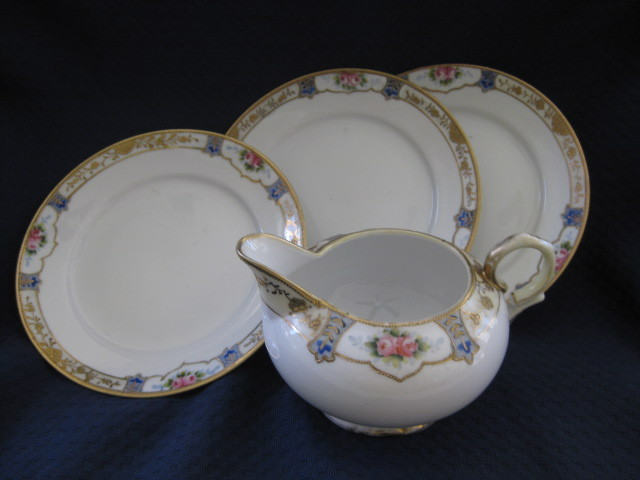 "Four Pieces of Noritake China- Three 6 1/2"" Plates with Creamer"