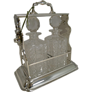 Outstanding Two Bottle Tantalus / Lockable Liquor Frame by John Grinsell & Sons