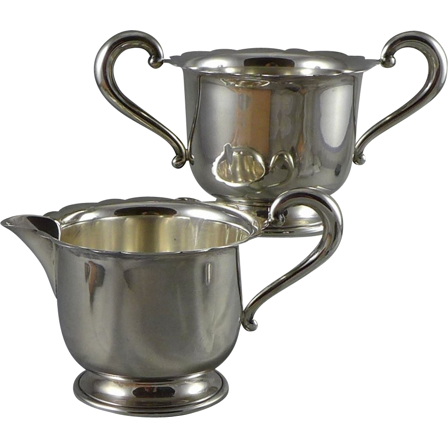 Vintage Sterling Silver Sugar And Creamer Set by Mueck Carey