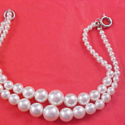 CHARMING - Two Strand Simulated  Graduated Pearl Bracelet