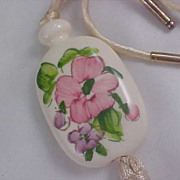AVON Porcelain Medallion on white Cord Necklace