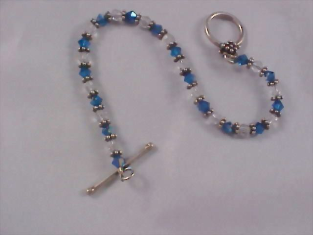 Sapphire Blue & Clear Crystals - Silver Rhodium Plate Rondels Bracelet