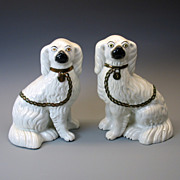 Early separated leg Staffordshire Cavalier Spaniel dog mantle pair