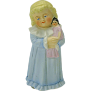 Victorian bisque figural candle snuffer-girl with doll