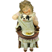 Big antique German bisque girl with puppy in chair figure