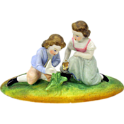 Victorian miniature bisque group for dolls-boy girl lily